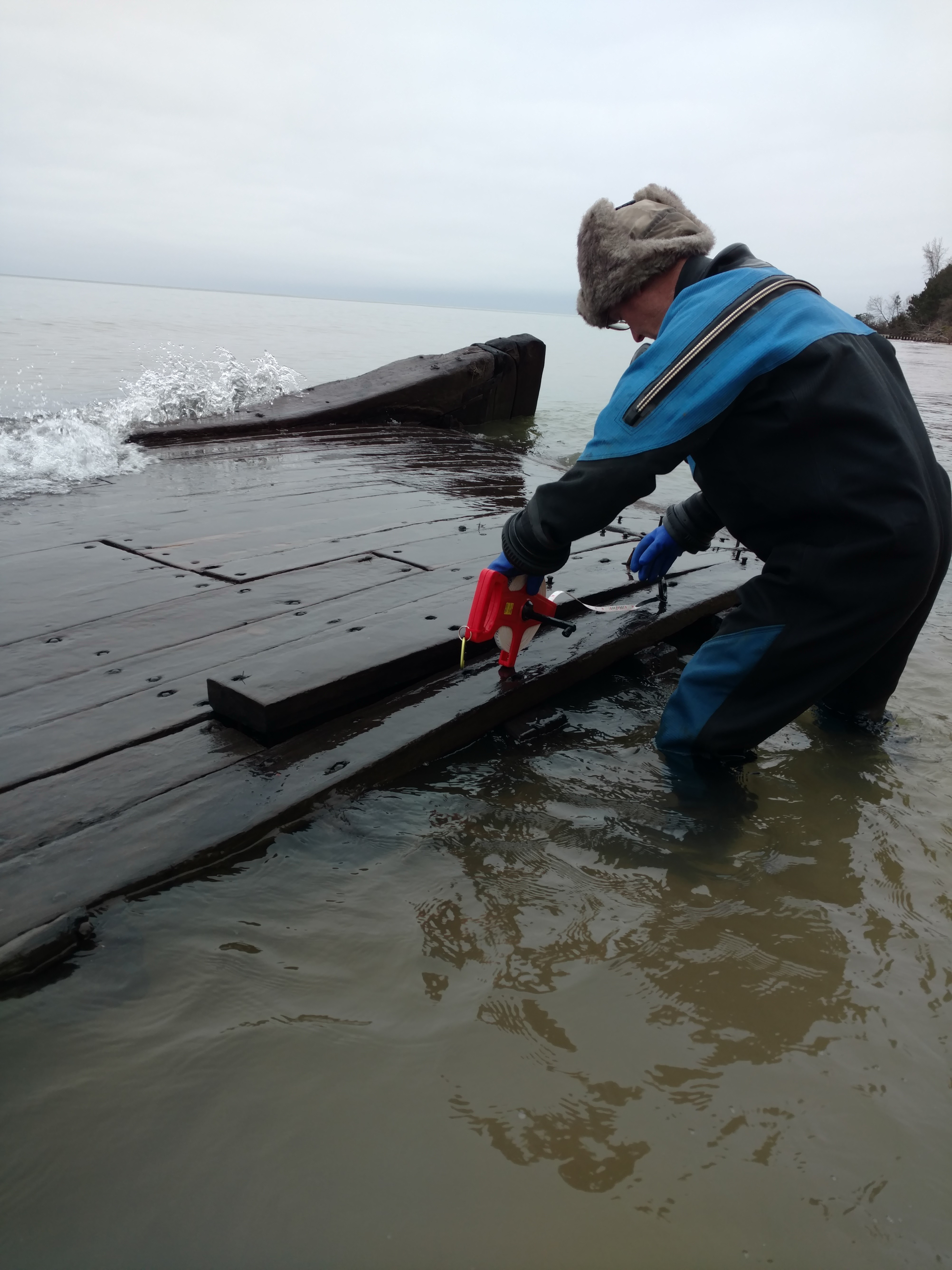 """""""Not a normal sailing ship;"""" Lake Michigan storm surge uncovers 19th century barge"""